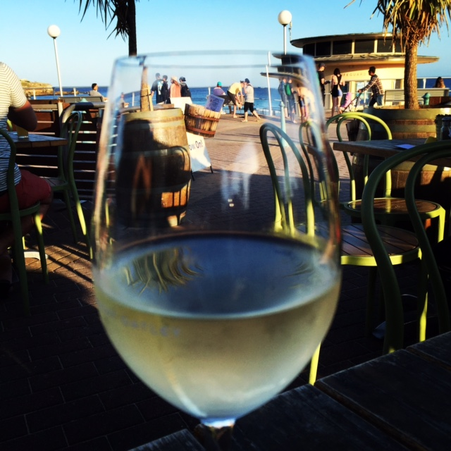 enjoying a glass of wine overlooking Bondi beach