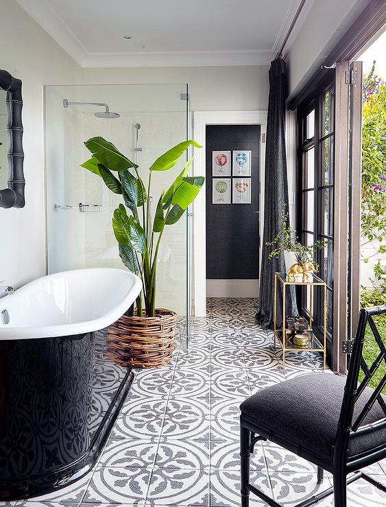 glossy-black-tub-concrete-floor-tiles-continue-into-shower