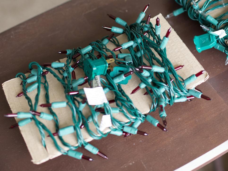 original_kim-christensen-cardboard-holiday-light-storage-jpg-rend-hgtvcom-966-725