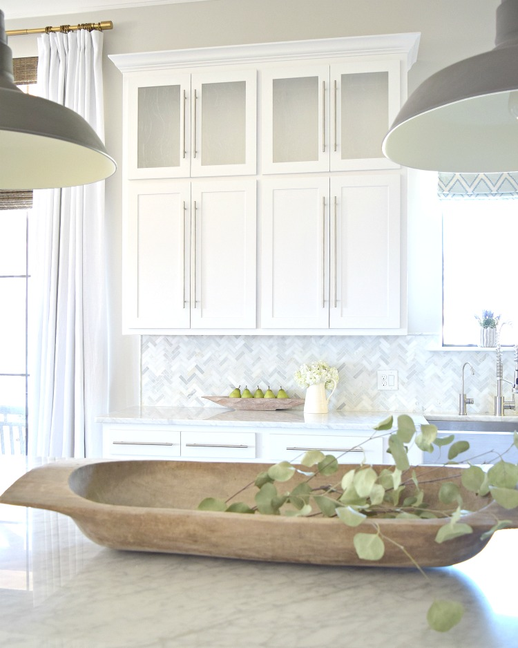 white-kitchen-herringbone-backsplash-dough-bowl-barn-pendants-carrara-countertops