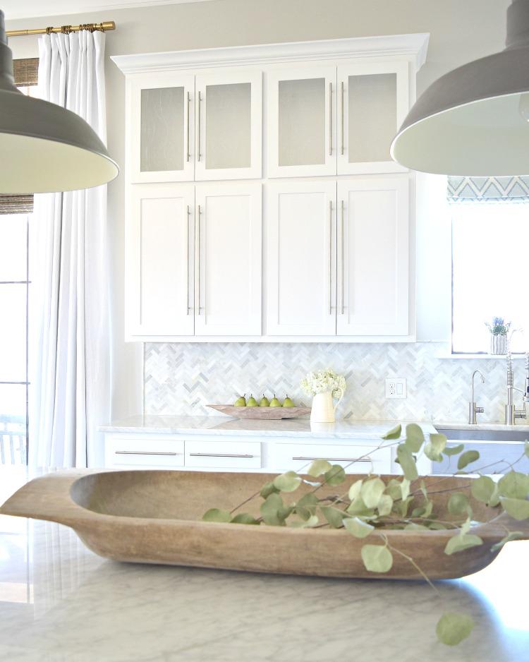 white-kitchen-herringbone-backsplash-dough-bowl-barn-pendants-carrara-countertops